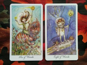 Ace of Wands and Eight of Wands (Joie de Vivre Tarot by Paulina Cassidy, U.S. Games copyright 2011)