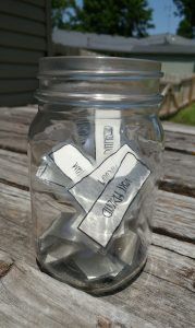 A mason jar filled with laminated paper tabs